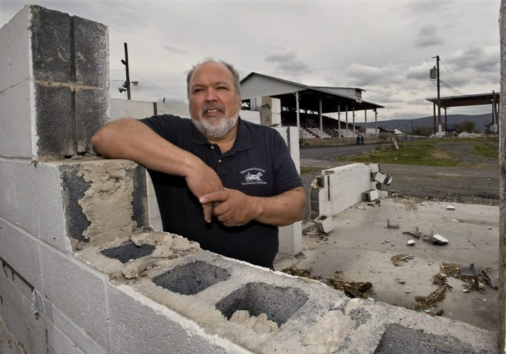 Tom Eshelman, general manager of the Shenandoah County Fair, stands inside the former Toms Brook United Methodist Church food stand that is one of several structures being demolished to make way for the new seven-lane banked harness racing track at the fairgrounds. The stage area, in the background on the right,  is also being razed as part of the new improvements.   Rich Cooley/Daily