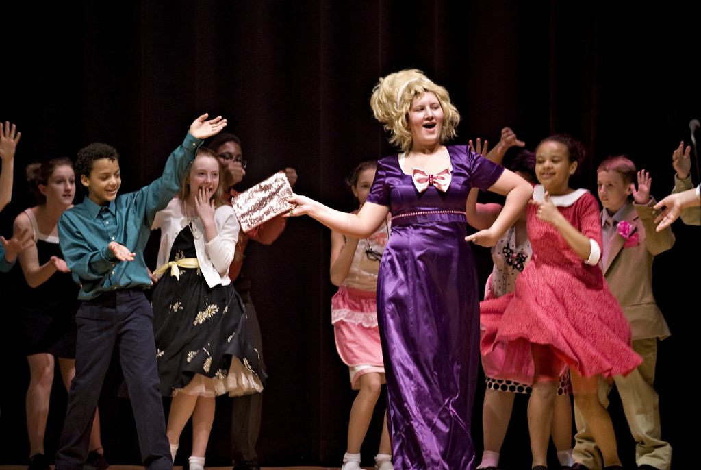Jocelyn Moyer and the rest of her classmates from Warren County Middle School rehearse the play Hair Spray inside the school's auditorium this past week.  Rich Cooley/Daily