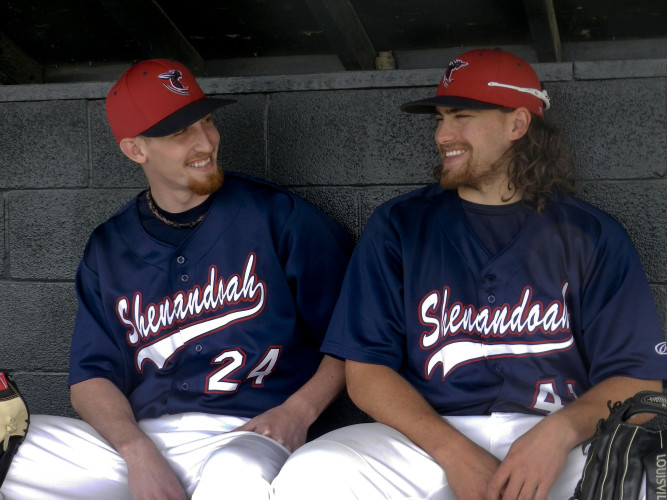 Shenandoah University baseball players Darrell  Thompson, left, and Mike Scimanico share a laugh while sitting in the dugout at Bridgeforth Field in Winchester recently. The seniors are in their final season atop the Hornets' pitching rotation.   Brad Fauber/Daily