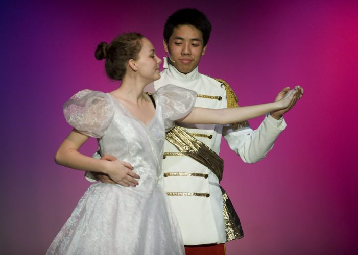 "Lindsay Bronston plays Cinderella and Richard Vois plays Prince Topher in Warren County High School's upcoming production of Rodgers and Hammerstein's ""Cinderella.""  Rich Cooley/Daily"