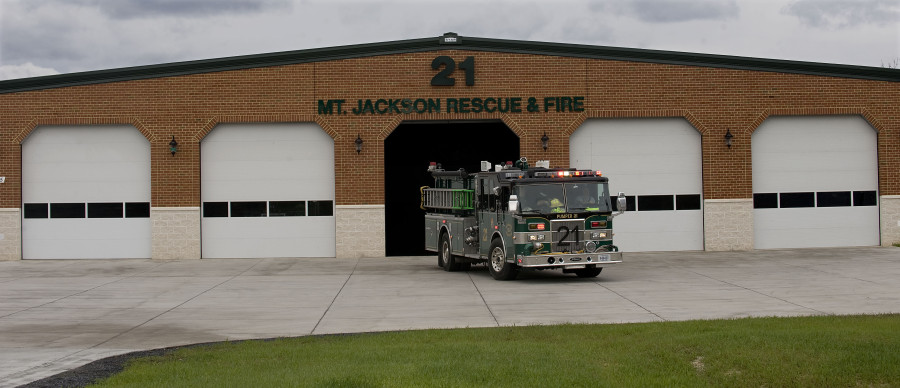 A firetruck backs into the new Mount Jackson Rescue and Fire station after a recent call. Rich Cooley/Daily