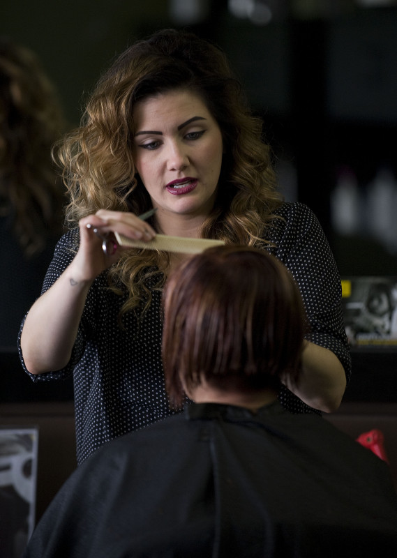 Ginger Hardy, hair stylist and owner of Twisted Hair Salon in Strasburg, works on a client.  She said the salon is looking forward to a busy prom season this year.