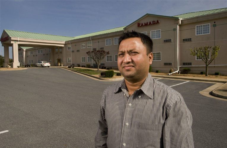 Nilesh Patel stands outside the Ramada Inn in Strasburg on Monday. Patel and five other investors recently purchased the hotel and adjoining restaurant from businessman Jerry King, of Strasburg.  Rich Cooley/Daily