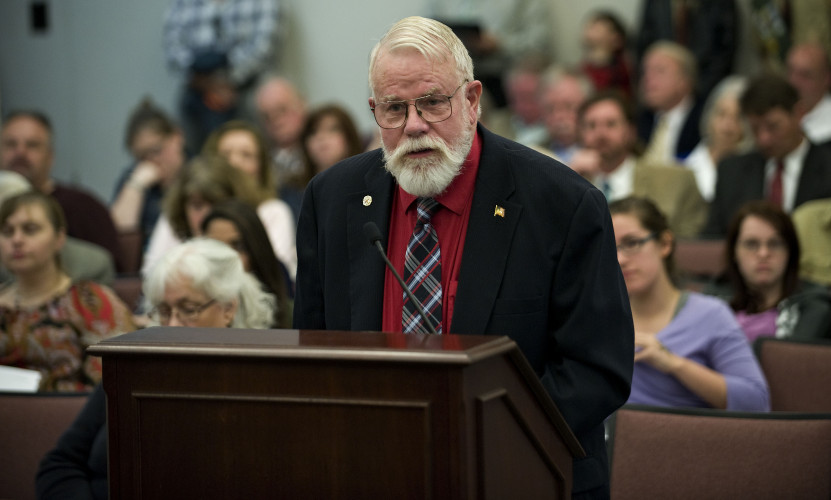 Charles Prince, of Front Royal, addresses the Warren County Board of Supervisors during its budget hearing Tuesday night at the government center. Eighteen area residents spoke during the public hearing.  Rich Cooley/Daily