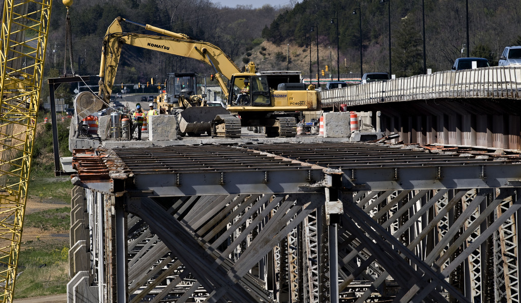Contractors continue the demolition of the old South Fork bridge in Front Royal. After the demolition, crews will add to additional lanes to finish construction on the new bridge. The $48.4 million project is scheduled to be completed in late 2017. Rich Cooley/Daily