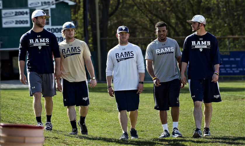 Former Sherando High School alumni John Bentley, Jacob Carney, Coach Matt McCarty, Tre Porter and Chase Smallwood walk across Fairfax Field at Shepherd University after a recent practice. McCarty, who became coach in July 2013, has helped mold competitive teams through his high school alma mater. Rich Cooley/Daily