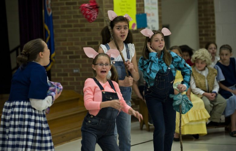 "Rachel Shafer, 11, left, plays Mrs. Sprat and Raea Crabill, Airi Layman, and Elizabeth Galloway, all 10, play the three little pigs in Sandy Hook Elementary's production of ""The Trial of the Big Bad Wolf."" Rich Cooley/Daily"