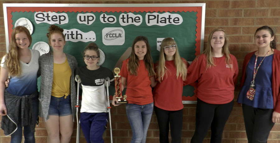 The Signal Knob Middle School FCCLA chapter will move on to the national competition in California this summer. From left are Aubrey LeBlanc, 13; Jana Bowman, 13; Seaira Warnell, 13; Kassidy Anderson, 12; Amanda Overturf, 14; Randi Ball, 14; and Megan Hibner, family and consumer sciences teacher and FCCLA adviser. Kaley Toy/Daily