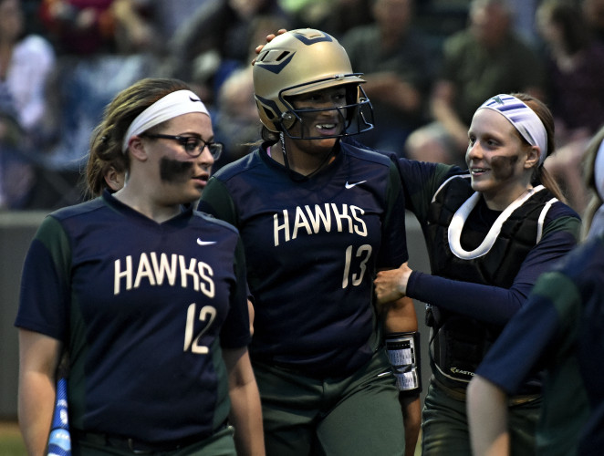 Skyline's Natasha Grayson, center, is congratulated by Rachel Sirbaugh, right,  after hitting a solo home run against Warren County earlier this year.  The Hawks play at Warhill today in a Region 3A East semifinal. Rich Cooley/Daily file