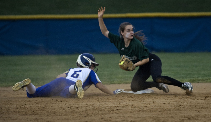 William Monroe shortstop Lacey Beale picks off Central's Lexi Rau on second base during third inning action Tuesday night in Woodstock. Rau overran the base on a bunt play and couldn't recover.  Rich Cooley/Daily