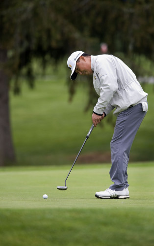 Yong Joo putts during the Apple Blossom Pro Am golf tournament on April 27 at Shenandoah Valley Golf Club in Front Royal.  Professionals will not be allowed to play in the golf tournament this year. Rich Cooley/Daily file