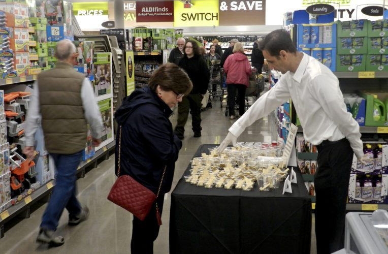 Lili Chamorro, of Front Royal, looks at cheese samples during the grand opening of Aldi on Thursday. Nathan Budryk/Daily