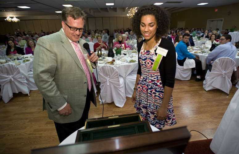 David C. Gum, president and CEO of Henkel Harris Furniture Co., unveiled this Henkel Harris jewelry chest gift for Queen Shenandoah designate LXXXIX Ahna Cameron during the Queen's Dinner held Thursday night at the Best Western Lee-Jackson in Winchester. The event, which is hosted by area civic clubs,  was sponsored by The Village at Orchard Ridge, The Northern Virginia Daily, and Barefoot Wine  Rich Cooley/Daily