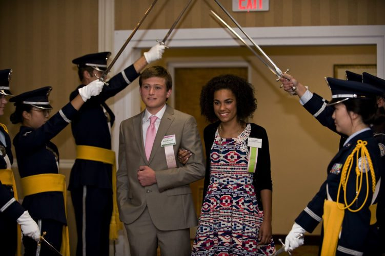 Queen Shenandoah designate LXXXIX Ahna Cameron makes her entrance to the Queen's Dinner Thursday night as she is escorted by  Kyle Kremer, 16, of Winchester Thursday night at the Best Western Lee-Jackson in Winchester. The event, which is hosted by area civic clubs,  was sponsored by The Village at Orchard Ridge, The Northern Virginia Daily, and Barefoot Wine  Rich Cooley/Daily