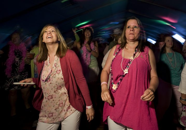 Kari Nichols, 31, left, and Missy Fletcher, 37, right, both of Winchester, dance to the band Souled Out during the Apple Blossom  Bloomers' Luncheon on Friday in Winchester. Rich Cooley/Daily