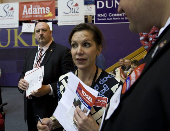 State Sen. Jill Holtzman Vogel, R-Upperville, stands beside Del. Todd Gilbert, R-Woodstock, as she speaks to Matthew Hall, of Roanoke, during the Virginia GOP convention held Saturday in Harrisonburg.  Rich Cooley/Daily