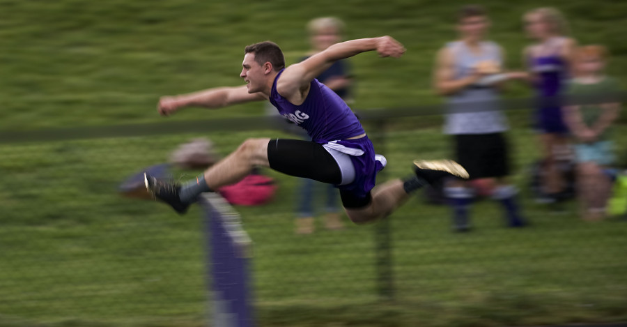 Strasburg's Elijah Waters clears the final hurdle in the boys 110 hurdle event during the Shenandoah County track meet Monday in Strasburg.  Rich Cooley/Daily