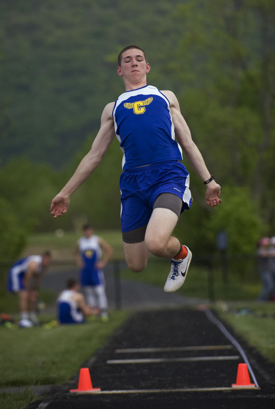 Central's Saxon Franklin leaps during the long jump competition last week at the Shenandoah County track meet in Strasburg. The Falcons are one of the favorites in the Bull Run District meet on Wednesday at Strasburg.  Rich Cooley/Daily