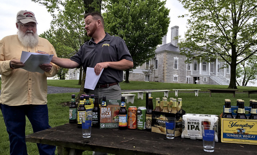 Belle Grove Program Assistant Rich Coyle, left,  discusses plans for the 21st annual Of Ale and History Beer Festival with Jay Massie, special event coordinator for Virginia Eagle Distributing. The festival will be held Saturday at Belle Grove.  Rachel Mahoney/Daily