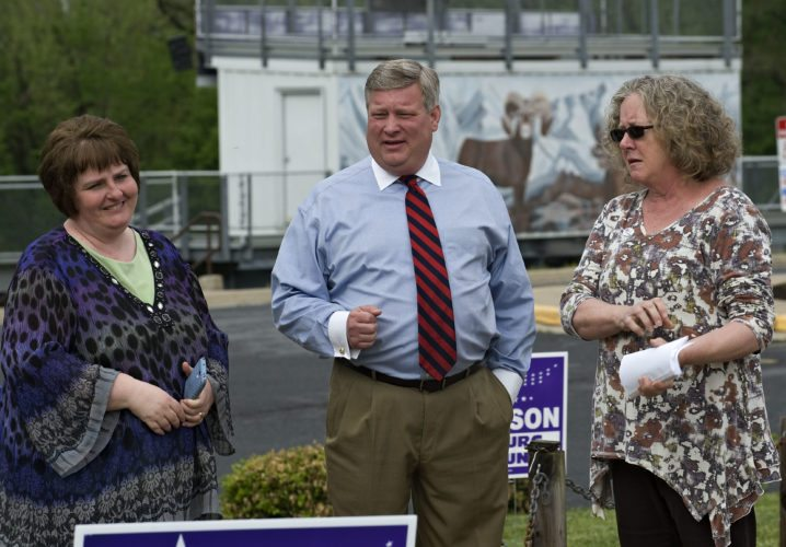 "Town council candidates Taralyn F. Manuel-Nicholson, left, and Barbara H. Plitt, right, stand outside the polls in Strasburg on Tuesday with mayor candidate Town Councilman Richard A. ""Rich"" Orndorff Jr., center. Orndorff won the three-way race against Councilman Donald M. Le Vine and former councilman Justin M. Ritenour. Rich Cooley/Daily"