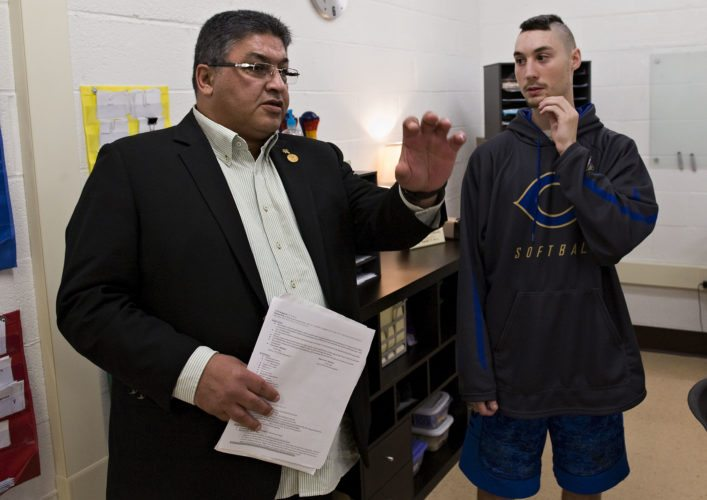 Ayman Wahab, left, president and managing director of Special Olympics in the Middle East and North Africa, chats with John Albright, 19, of Toms Brook, while Wahab tours Central High School's L.I.F.E. program Thursday afternoon. Wahab is starting a foundation focused on inclusive education and was touring the school's special education departments.   Rich Cooley/Daily
