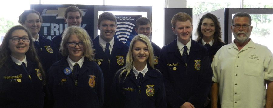 """Robert """"Bobby"""" Grubbs, owner of Grubbs Chevrolet, far right, recently donated funds to Shenandoah County FFA students for their trip to the Washington Leadership Conference.  Also pictured, from front row left, are Hannah Orndorff, of Strasburg High School; Jessica Miller, of Stonewall Jackson High School; Jenna Kibler, of Central High School; and Jacob French, of Central High School. From back row left, are Faith Funkhouser, of Stonewall Jackson High School; Joseph Foltz, of Central High School; Nathan McDonald, of Strasburg High School; and Isaac Rhodes, of Central High School. Courtesy photo"""