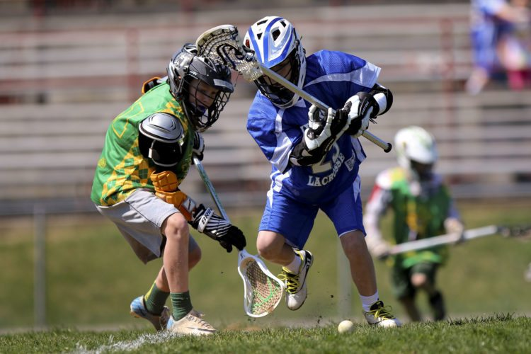 Kyle Bordner (blue) of the Front Royal Rippers competes for control of the ball with Caleb Kemer of the Winchester Vipers during a recent lacrosse match. Shenandoah Valley Youth Lacrosse will be holding a tournament Saturday in Front Royal.   Photo courtesy of SVYL