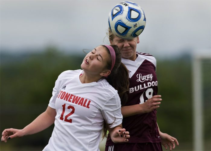 Stonewall's Virginia Biller and Luray's Brianna Stephens go up to head the ball during the first half of Tuesday's soccer match in Quicksburg.  Rich Cooley/Daily
