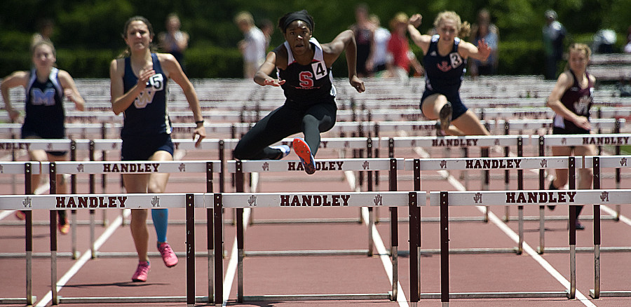 Sherando's Davina Lane leaves the competition behind in the 100-meter hurdles during the Conference 21 Track and Field Meet on Thursday at Handley High School.   Rich Cooley/Daily
