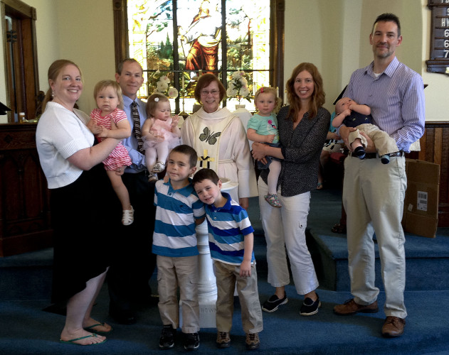 Bethel Lutheran Church in Edinburg welcomed seven children and two adults on May 8 during a service of the Sacrament of Holy Baptism. Children received gifts of a children's Bible, baptismal linen cloth and  a candle. Those children baptized were, front row, Andrew and Bradley Shiley; second row, Hannah Vallen (held by Tracie Smoot), Jason and Leena Shirkey, Katie Moton (held by Heather Moton), and Mike and Tyler Moton. Pastor Karen Caspersen, center, presided over the service. Courtesy photo