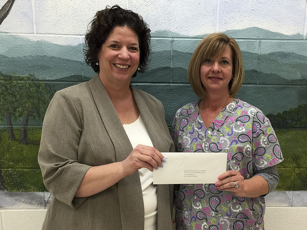 Debbie Connolly, executive director of the Community Foundation of the Northern Shenandoah Valley, presents a distribution check for $2,500 to Lavenda Denney, executive director of the Humane Society of Warren County. The foundation distributed more than $14,000 to nine local nonprofits in April. Other organizations that received donations in April were Belle Grove Inc., Blue Ridge Arts Council, Front Royal Women's Resource Center, AbbaCare, Fremont Street Nursery, Henry and William Evans Home Inc., Warren County Educational Endowment and the Winchester SPCA. Courtesy photo