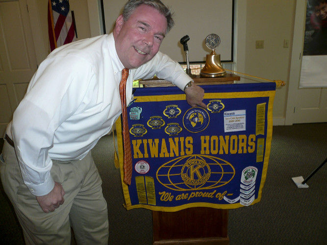 Bill Armstrong, past president of the Kiwanis Club of Old Town Winchester, attaches an Honor Banner Patch designating the club as a distinguished club for his year as president. The club was cited for the amount of community service it contributed to the community. The club celebrates its 10th year of operation.  Courtesy photo