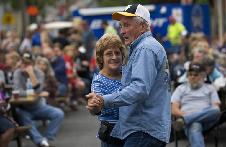 Shirley Mullaney, of Strasburg, and Gaylon Miller, of Mt. Olive, dance to the band John Richards and The Virginians at the Mayfest Street Dance in the BB&T bank parking lot Friday night in Strasburg. Mayfest continues today and Sunday, with a parade at 4 p.m. today.  Rich Cooley/Daily