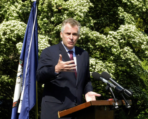 Gov. Terry McAuliffe discusses House Bill 912 during a bill signing on Tuesday at Blandy Experimental Farm and State Arboretum of Virginia. The bill will allow broadband cables to run along public highways to bring internet access to rural areas.  Rachel Mahoney/Daily