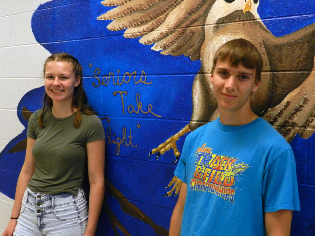 Skyline High School seniors Gabi Huebner and Christian Madden stand in front of the mural in the school's senior lounge. Rachel Mahoney/Daily