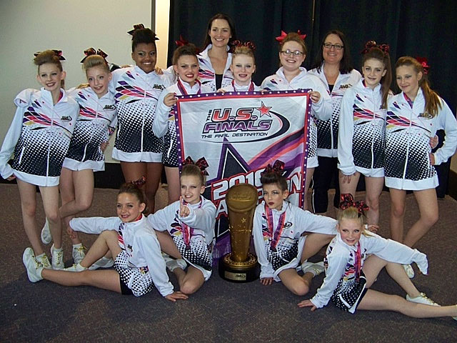 The Cheer Eruption Youth Prep Level 2 team has been crowned the top-ranked team in the country. Showns here are, back row from left,   Madison Burner, Kaylee Via, Malacia Dickey, Dorthi Cunningham, Coach Samantha Facemire, McKenna Southern, Emmy Ridings, Coach Anne Gorman, Bailey Evans, Alexis Hyre; and front row, from left, Kyla Vaught, Emilie Rose, Annalise Sison, Hailey LaFever. Courtesy photo/Anne Gorman