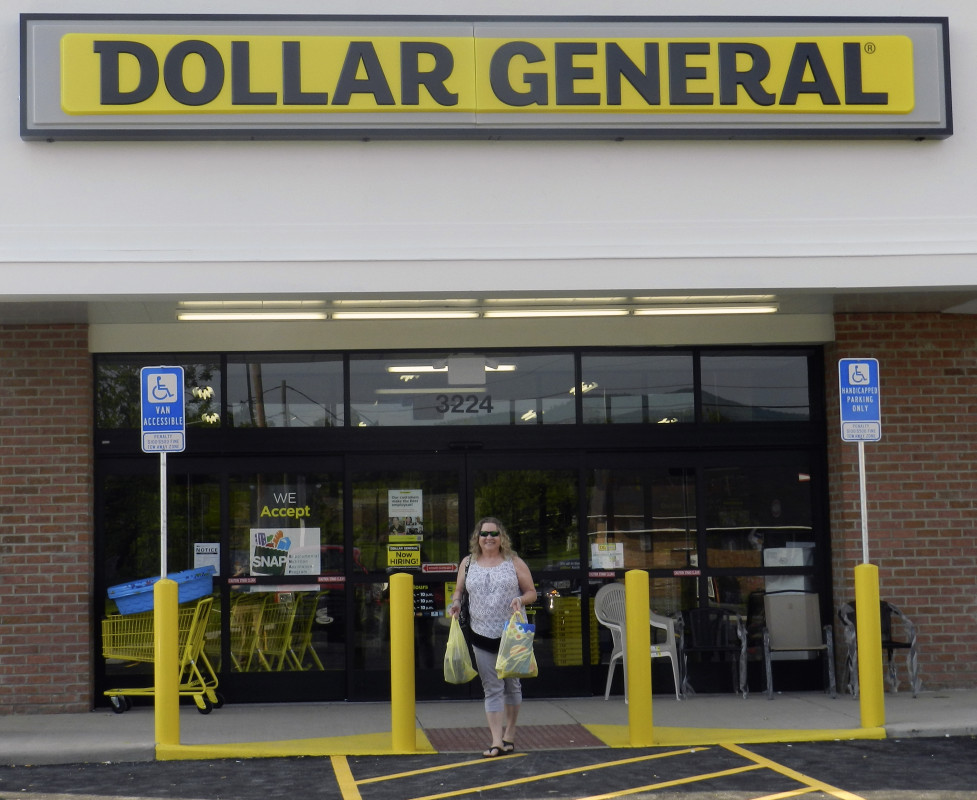 Teresa Funkhouser, former mayor of Toms Brook, leaves the town's new Dollar General store after purchasing some groceries. The store opened for business on Thursday. Funkhouser said the addition of the store is great news for Toms Brook. Nathan Budryk/Daily