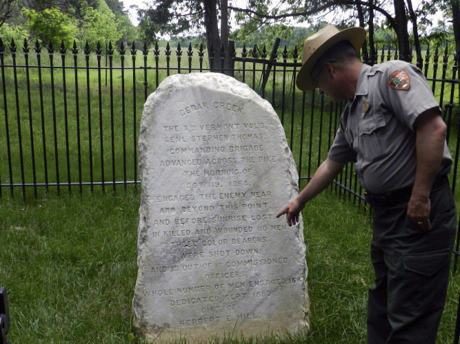 Eric Campbell, chief of interpretation for Cedar Creek and Belle Grove National Historical Park, looks at the monument commemorating the fallen members of the 8th Vermont regiment. The trail leading to the monument is one of three new Morning Attack Trails to open Saturday.  Nathan Budryk/Daily
