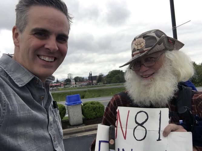 Jason Wright, left, captures a photo of the Hiking Pilgrim on Interstate 81. Courtesy photo