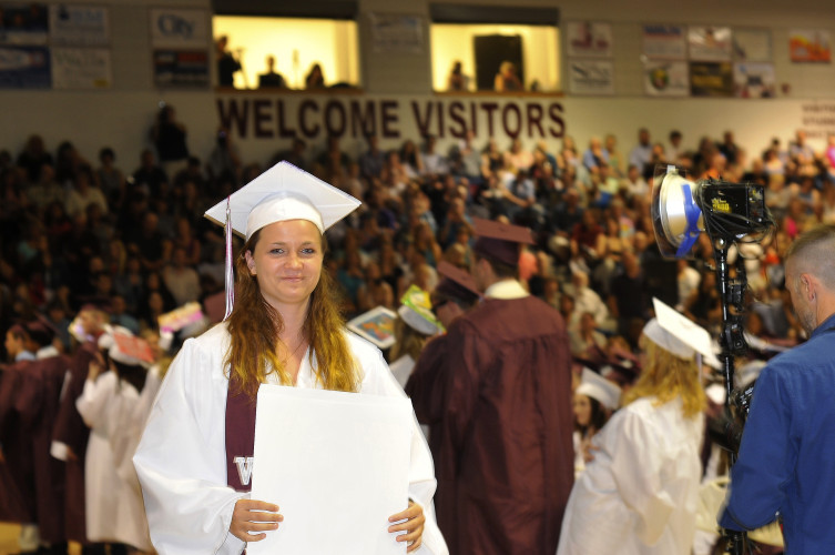 Chelsey Butler, vice president of the class of 2016, holds her diploma at Warren County High School's graduation Friday.  Jake Zuckerman/Daily