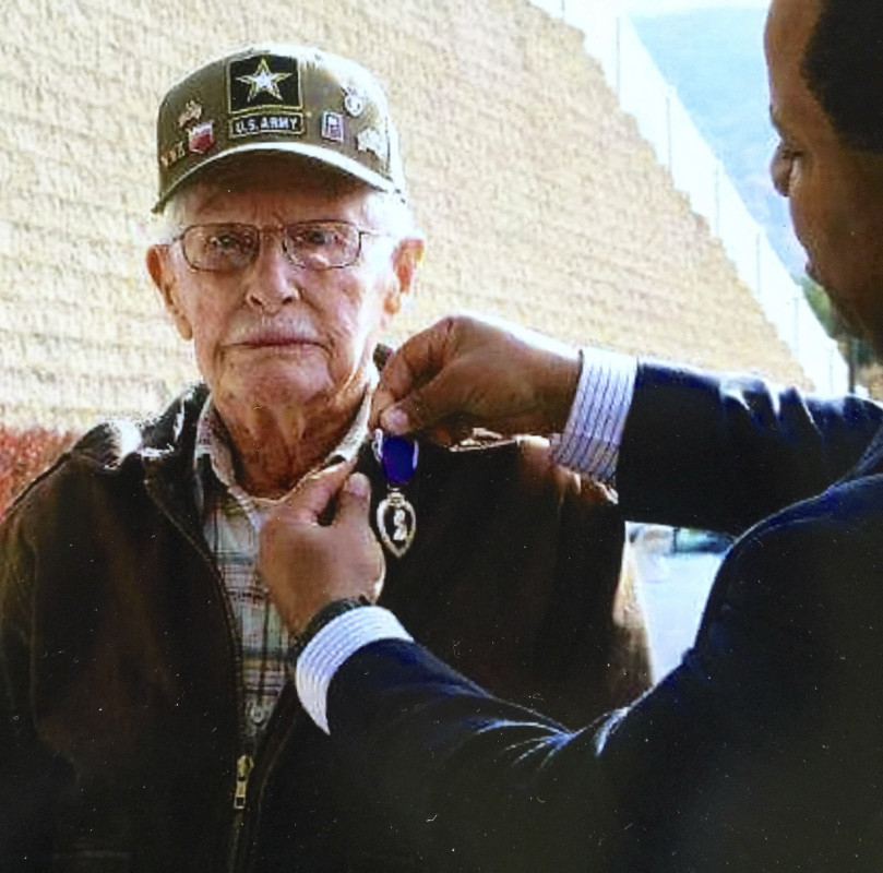 Donald Keller, 93, a World War II Army veteran from Strasburg, was presented with a Purple Heart by Commissioner John L. Newby II, of the U.S. Department of Veterans Affairs, at a recent ceremony in Strasburg.  Photo courtesy of Deanna Boyer