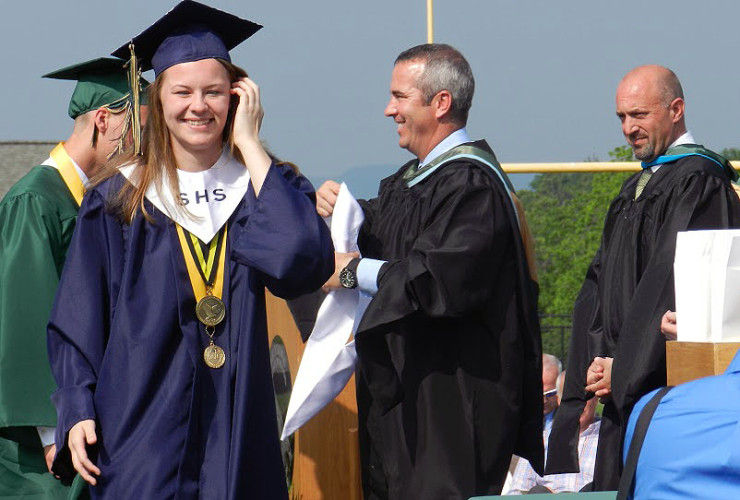 Distinguished honor graduate Gabriella Huebner descends the stage stairs after receiving her stole at Skyline High School's commencement ceremony May 28. Distinguished honor graduates were those students who achieved a GPA of 4.0 and above. Nathan Budryk/Daily
