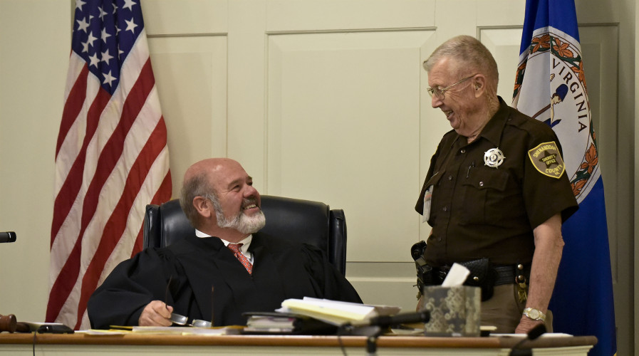 Shenandoah County Circuit Court Judge Dennis Hupp, left, chats with court bailiff Buddy Hoover, 85, who worked his last day on Tuesday. Hoover has worked as bailiff for the past 22 1/2 years.  Rich Cooley/Daily