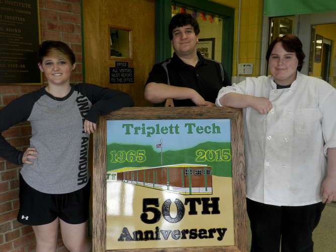 Among students graduating from Triplett Tech on Thursday are, from left, Maggie Frasure, 17, of Strasburg, Arty Richel, 17, of Mount Jackson, and Kayla Kibler, 17, of Woodstock . Kaley Toy/Daily