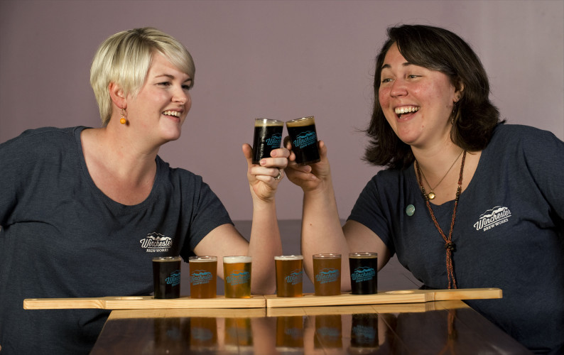 Holly Redding, left, and Bonnie Landy are co-owners of Winchester Brew Works on North Cameron Street in Winchester. The brew house features several beers and offers new flavors each week. Rich Cooley/Daily