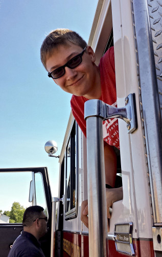 Robert E. Aylor Middle School eighth grade student Dylan Cadd looks out the window of a fire truck parked at the third school-wide career fair. Photo courtesy of Kim Black