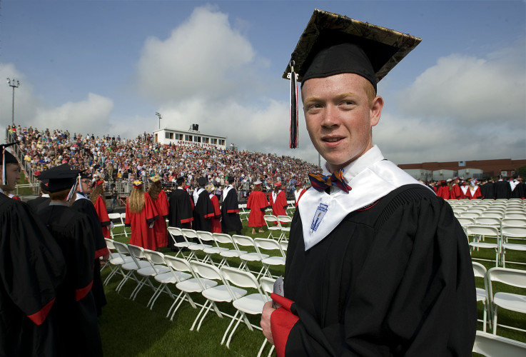 Sherando senior Brandon Teets, 18, of Stephens City, walks to his seat during the start of commencement ceremonies Saturday morning at Arrowhead Stadium in Stephens City. There were 316 seniors who received their diplomas, marking the largest 2016 graduating class in Frederick County. Rich Cooley/Daily