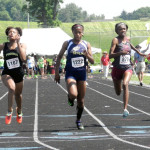 Skyline sophomore Olivia McGill, center, crosses the finish line just behind Phoebus' Amira Aduba in the girls 100-meter dash during Saturday's Group 3A track and field state championships in Harrisonburg. McGill was second in the race.   Brad Fauber/Daily