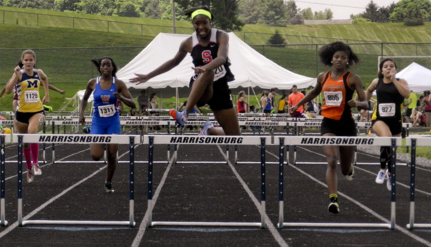 Sherando junior Davina Lane jumps the final hurdle during the girls 300-meter hurdles in the Group 4A track and field state championships in Harrisonburg. Lane won state titles in both the 100- and 300-meter hurdles. She had a standout season in both track and basketball.  Brad Fauber/Daily file