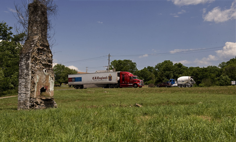 Traffic from U.S. Route 522 travels past an empty lot at McKay Springs at Reliance Road.  Rich Cooley/Daily